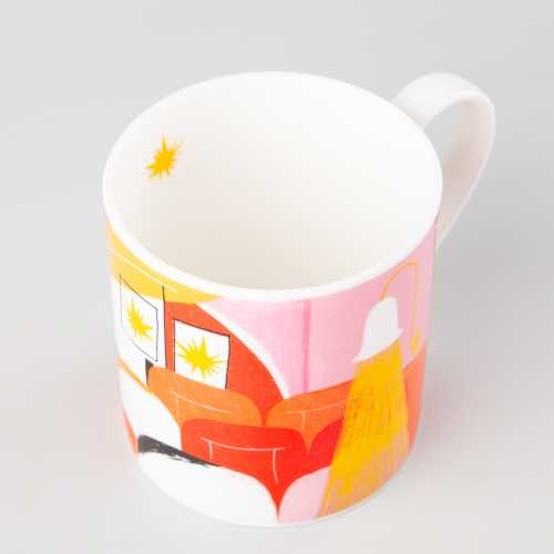 Photograph of mug with colourful, abstract cinema illustration